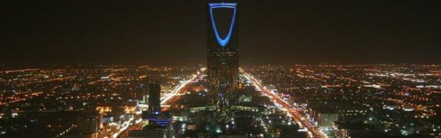 Image:  Night view of Riyadh, by Ammar Shaker via Wikimedia Commons.